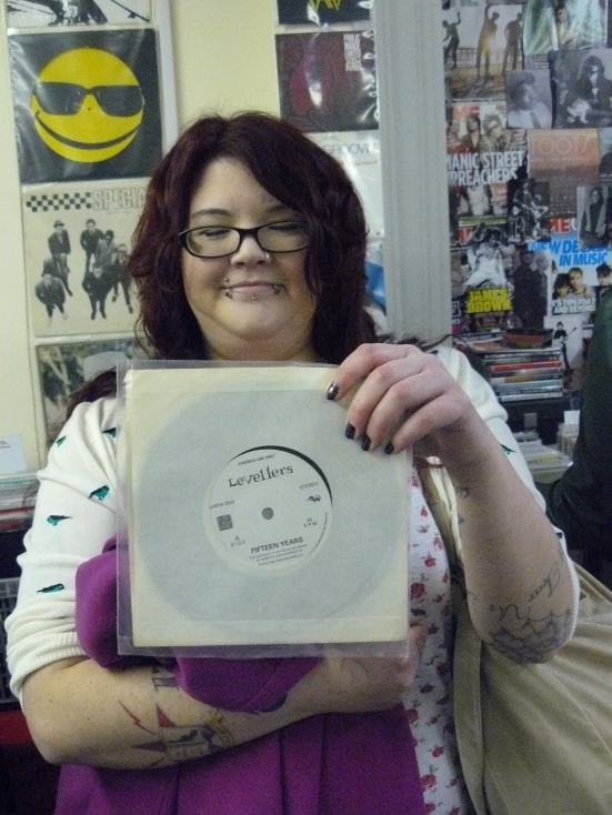 Catherine Loughlin brought her copy of The Levellers' Far From Home/Fifteen Years.