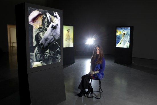Artist Linder with her work in exhibition at The Hepworth Wakefield, 2013 Photo: Gabriel Szabo / Guzelian © The Hepworth Wakefield