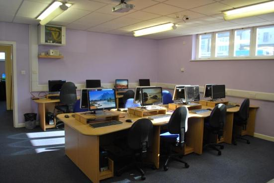 One of a number of training rooms available. - Contains 12 PC's, Windows Vista, Office 2003/2007, Adobe and Macromedia software. Interactive Whiteboard, 2 Colour Laser Printers plus any required teaching aids. This room accommodates 14 Students.