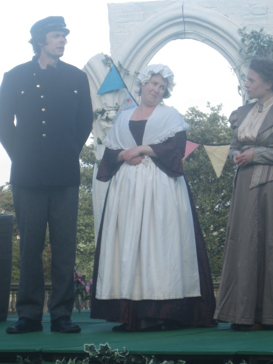 Helen Fullerton as the maid Mrs Mortimer, with Mark Watson as Chief Constable Crabbe and Mollie Fyfe-Taylor as Henrietta Baskerville.