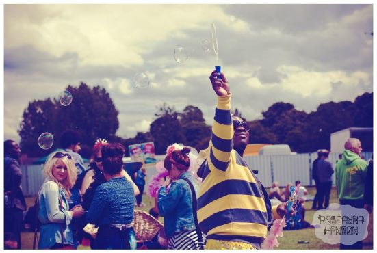A bubble-blowing bumble bee roaming the park handing out free lollipops and cakes!