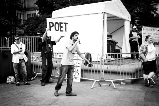 A poet performs in the Peace Gardens © Roseanna Hanson