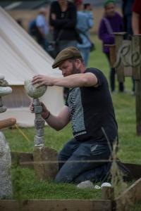 James Brunt of Responsible Fishing UK, stone balancing © Lewis Ryan